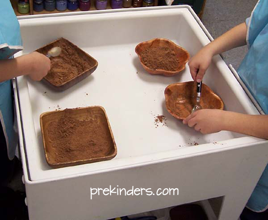 Transferring Cocoa in the Sensory Table